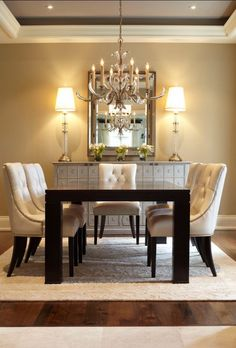 Symmetry. Love tall lamps on sideboard