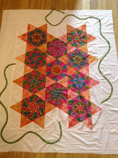 Adding a vine / stem to my quilt border.  1st time I used my fast turner.  Now some triangle shaped leaves and flowers.  By Dawn