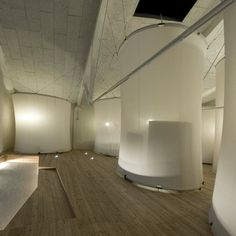 Antonio Ravalli Architetti have converted an old factory in Migliarino, Italy, into a youth hostel where guests can stay in these tall fabric-covered pods.