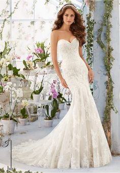 """Wedding Gowns By Blu featuring Embroidered Lace Appliques on Net Over Soft Satin with Scalloped Hemline Available in Three Lengths: 55"""", 58"""", 61"""". Colors available: White, Ivory, Ivory/Coco."""