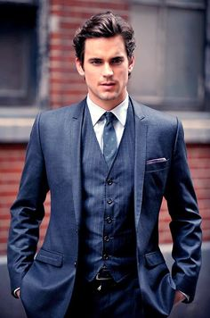 I love blue suits! Nice playful pocket square here.