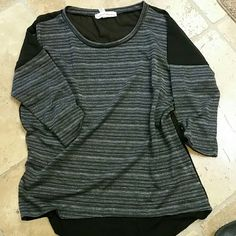 French Laundry Top Black with silver threads.  Shimmering  re posh.  Didn't fit. French Laundry  Tops