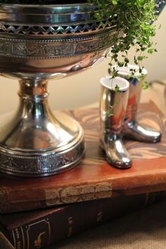 Pretty Decor ~ a silver urn and silver riding boots, just beautiful.