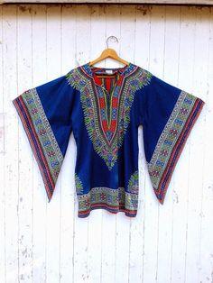Hey, I found this really awesome Etsy listing at https://www.etsy.com/listing/192602348/70s-dashiki-ethnic-boho-mini-dress-angel