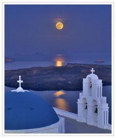 Moonrise over Santorini, Greece.