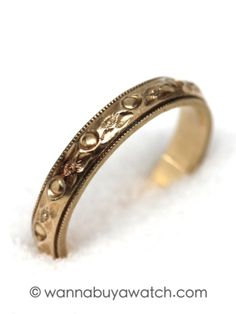 Antique 14K YG Wedding Band. 14K yellow gold wedding band with raised foliate 7 circles bordered with milgrain edges. 3.5mm wide size 7. Very pretty design, with sharp detail.