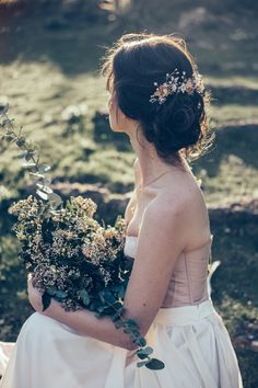 A romantic look with the hair style and accessories. Makeup and Hair Storme Webster, Storme Makeup Model Eve Ainsbury Venue Danesfield House Photographer Kitty Wheeler Shaw Corset Jessica Turner Designs Jewellery and Hair Pieces Beverly Pile, PS With Love Florist Eram Khan, Boom Blooms Cake Kate Roche Lieberman, Dolce Lusso Cakes Stationery Holly Rees, Holly Rees London Tableware Daniela Johnston, Classic Crockery