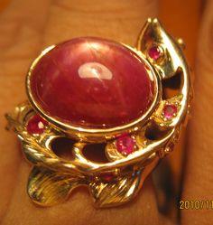 Nhẫn cá rồng ruby sao, vàng hông 18k, đã bán     http://phongthuyvadoisong.com/  http://phongthuyvadoisong.com/445/San-Pham/ruby-da-quy-ruby-sao-do.htm