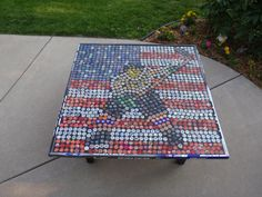 Over 1,000 beer caps used to make a custom table for my cousin and his wife.  They both were Division 1 hockey players who are really into America.  I used their hockey sticks for the sides.  I loved doing this and if anyone is interested in a custom table I would be more then willing to make them one.