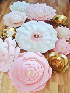 Paper Flower Backdrops are a cool and refreshing way to enhance the decor for your wedding or event. We send you the flowers and you use them to create a dream DIY backdrop for your event.  Flowers come completed (no assembly required). Offering a varied look with flowers ranging in sizes of 12 inches to 24 inches with jewel and/or paper centres. This kit will include:  - 15 white flowers between 12 to 30 inches. - 15 blends of light pink flowers between 12 to 30 inches. - 5 gold flowers...