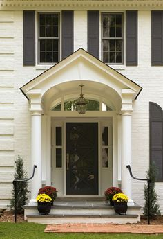 Traditional portico, slate porch, painted brick rises