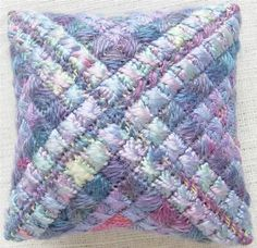Space dyed wool, silk of varying weights, mohair threads. cushion stitch, rhodes stitch, upright cross stitch.