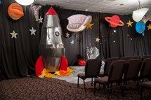 Create the scene with planets, stars, and black backdrop. More great VBS decorating resources can be found at http://group.com/vbsTools.