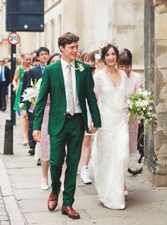 Love this groom's emerald-green suit.