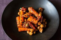 Moroccan Carrots made with cinnamon, nutmeg, cumin, paprika, caraway, ginger, garlic, chickpeas, canned tomatoes, honey, cilantro