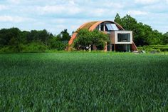 Crossway House (The Eco Arch), Kent, England: Simple, iconic, ecological design which ties in with traditional local architecture (tiling and weather board). Roof Design, Exterior Design, House Design, Round Building, Building A House, Organic Architecture, Contemporary Architecture, Ecology Design, Passive House