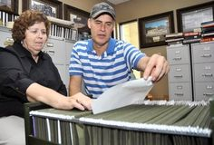 """Carol Bradford, archivist assistant, and Glenn Jones, archivist, look through folders at the Putnam County Archives that house information on 90 different historic communities in Putnam County. They are asking members of the community to contact them with any information about """"almost forgotten"""" communities. Anyone with information or photos about local historic places like schools, grist mills, blacksmith shops, stores and post offices are asked to call 931-520-0042. Ty Kernea…"""