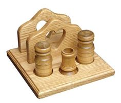 The napkin holder with heartdesignincludesa salt and pepper shaker and toothpick holder.