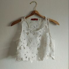 White Floral Crop Top Super cute for Spring/Summer to wear with high waisted shorts or your favorite maxi. This would be gorgeous to wear wine tasting or on a tropical vacation with a nice tan. Only signs of wear are on the inside. Not visible from the outside or when worn. Size is a small but I believe it would be better for an XS. No trades. No PP. Open to offers. Tops Crop Tops