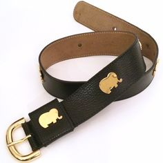 """Furla Vintage Black Gold Elephant Waist Belt Absolutely gorgeous vintage piece by designer Furla. Made in Italy. Black leather with gold elephants all over. Says size """"70"""" which I'm guessing is cm. This works as a waist belt. It would fit a size XS or Small waist. (It is not meant to be worn through jeans or hips.) can fit a size 25-28.5 inch waist! Really unique piece and still in great condition!! Furla Accessories Belts"""