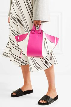 Fuchsia and white leather (Calf) Hook fastening at open top Designer color: Shocking Pink Comes with dust bag Weighs approximately 3.1lbs/ 1.4kg Made in Spain