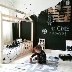 Such a cool kid room. I love the paint design on the wall.