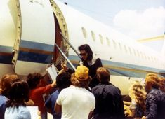 Signing autographs for some fans before boarding his plane in Oklahoma City, OK enroute to Terre Haute, IN on July 9, 1975