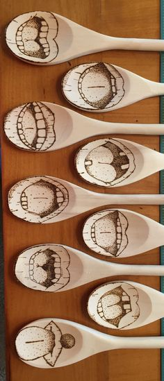 Wood burned spoons with mouths on them