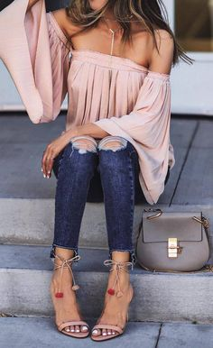 A blush off shoulder top that`ll have everyone under your spell