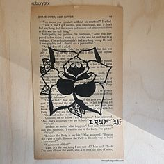 An early page painting of a traditional tattoo style rose onto a pulp fiction novel from the 1960s.  mrcrypt.bigcartel.com