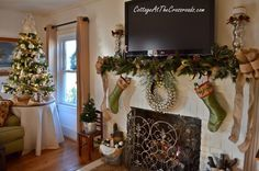 Nice way to manage the mantel when there's a flat screen TV involved above it!