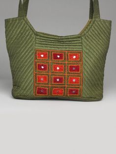 Green embroidered quilted bag  $35    http://www.indianmyra.com/products/Green-embroidered-quilted-bag.html