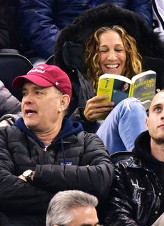 Surprise! Sarah Jessica Parker sits behind Tom Hanks at an hockey game in NYC on Tuesday, March 24.