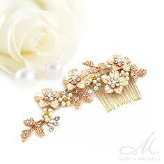 Romantikus, virágokkal díszített menyasszony fésűs hajdísz, trendi rozé arany színben. A fésű nikkelmentes fémből készült, rozé arany bevonattal, nem okoz allergiát.