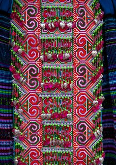 Colors: Red, white, pink, neon yellow... Details Of A Traditional Flower Hmong Cloth, Sapa, Vietnam