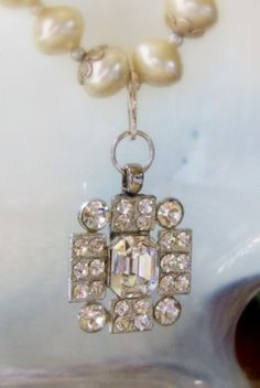 Vintage rhinestone button that's been attached to pearls