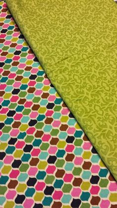 Colorful repeating pattern w/ green floral print.