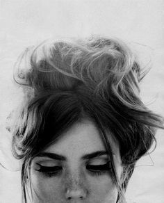 Messy updo, winged liner and lots of mascara.