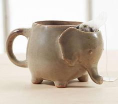 This tea mug is shaped like an elephant and has a little pocket in the animal's head where you can store your used tea bag after it's done brewing. The cute tea mug is made with 4 stubby little elepha...