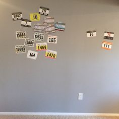 Pin bibs from races to a wall