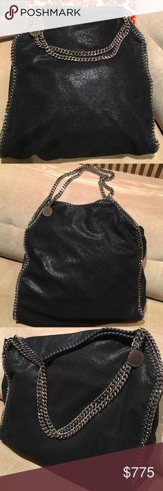 """Stella McCartney Falabella Shaggy Deer Big Tote Stella McCartney black vegan suede Falabella Shaggy Deer Big Tote.  Whipstitched trim accented w/ silver-tone metal chain & logo medallion.  Logo-jacquard fabric lining; Interior- zip & cell phone pockets Magnetic-snap closure Approx 15.5"""" HT x 16"""" W x 3.5"""" depth; 9"""" handle drop Detachable market purse Made in Italy  Overall LIKE NEW Condition. Only used a few times. Interior is clean & in excellent condition w/ exception of small makeup stain…"""