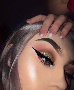 gold glitter shadow + sharp liner