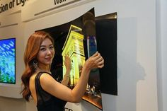 Want a paper-thin OLED TV that sticks on the wall with magnets? LG's got it
