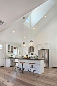 white kitchen, vaulted ceiling, grayish floor