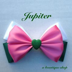 Up for your consideration is a custom made Jupiter hair bow.    The bow measures 5 inches wide and 3 inches tall. I will attach whichever clip you