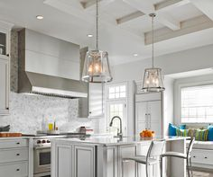 Herringbone backsplash and beautiful pendants