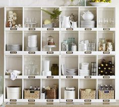 wall of cubbies - baskets on the bottom for tablecloths etc.  3 wide instead on bottom idea for pantry storage