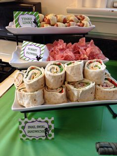 Fairy party food===Top tray is Pigs in a blanket===Middle tray could be any meat that you fold to make look like flowers===Bottom tray can be any lunch meat and lettuce and other veggies and cheese rolled in a tortilla wrap. Simple but oh so yummy. Image Only