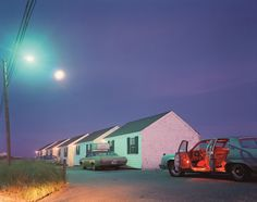 Joel Meyerowitz  Captured the changing light at sunset -- warm pink light from the setting sun in the west; green light from the sodium pole lights; red lights inside the car; the moon has already risen. Complex and wonderful.