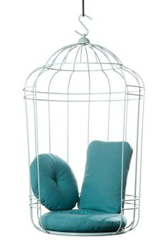 Wiegend met je tenen door het gras en je rug tegen een zacht kussen. Niet gevangen, maar zo vrij als een vogel! - Cageling